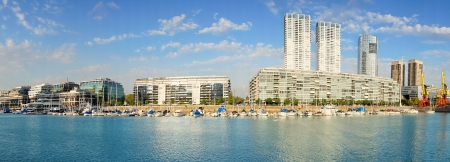 puerto: Panoramic view of marina and downtown buildings at Puerto Madero neighborhood in Buenos Aires, Argentina
