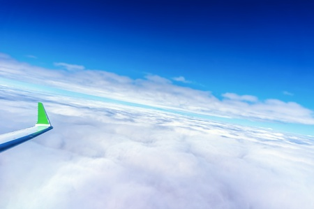 Airplane on flight above the clouds photo