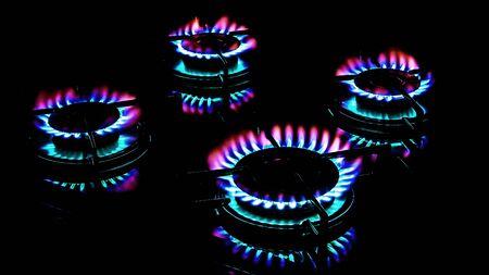 butane: Gas ring burner in the dark kitchen oven  Stock Photo