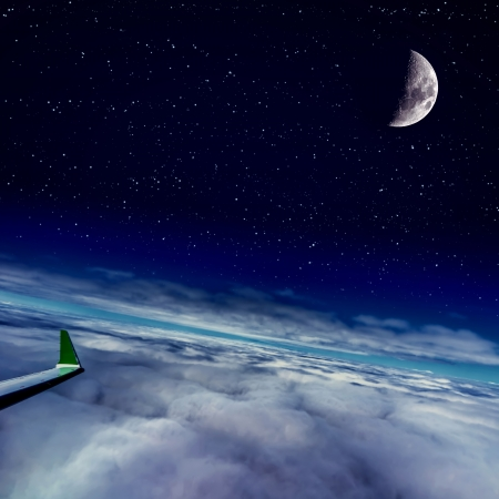 Moon and clouds  Night scene  Airplane on flight  photo