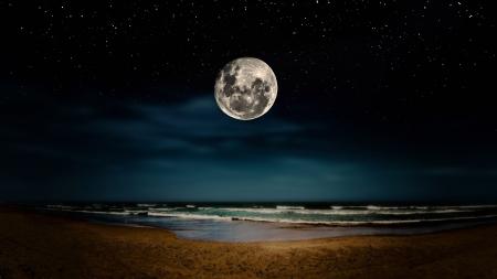 luz de luna: Luna llena reflejada en la playa