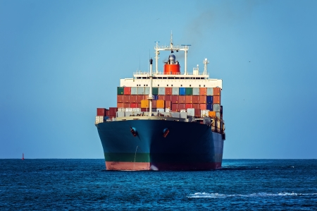 ship bow: Container cargo ship in ocean Stock Photo
