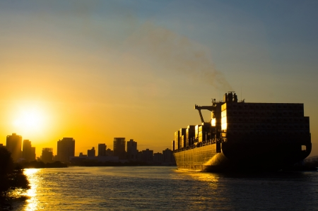 Sunset container cargo ship in ocean photo