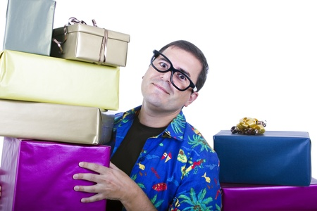 young casual man holding gifts