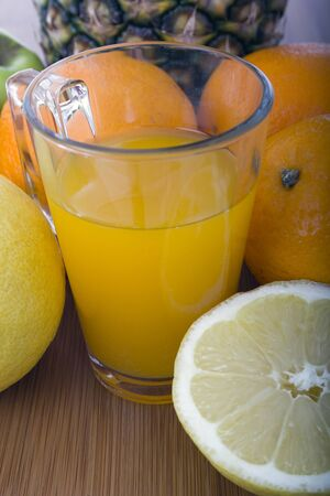 glasse of orange juice and fruits Stock Photo - 17070873