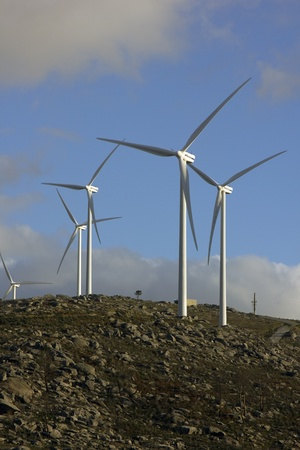 white wind turbines in the top of the mountain Stock Photo - 17070948