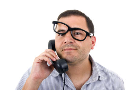 young man with a phone and glasses, isolated on white  Stock Photo - 17071038