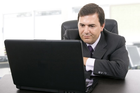 Business man working with is laptop at the office Stock Photo