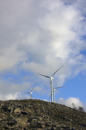 white wind turbines in the top of the mountain Stock Photo - 17071319