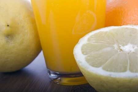 glasse of orange juice and fruits Stock Photo