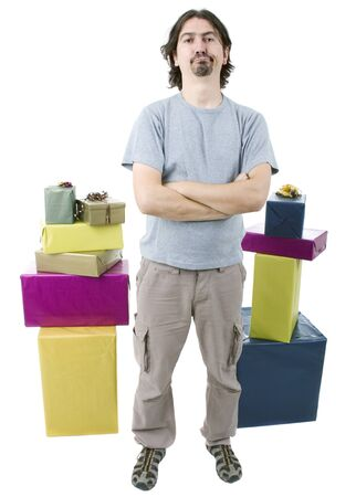 young casual man holding gifts, isolated  Stock Photo