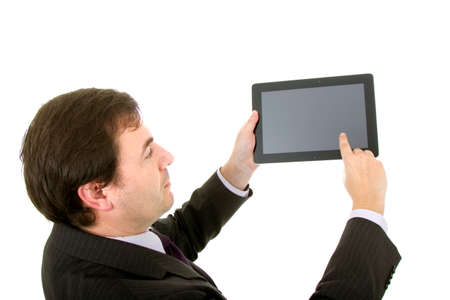 Young businessman using tablet pc while standing white background Stock Photo