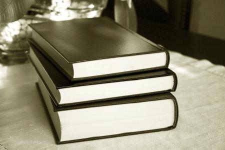 Vintage old books on wooden deck tabletop photo