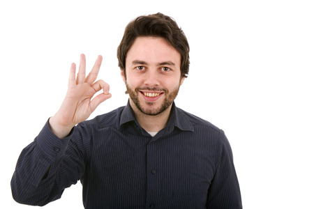 Young casual man making the ok gesture on a white background Stock Photo