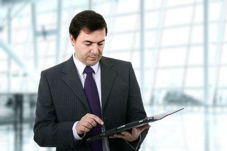 Businessman using a tablet pc on the office Stock Photo