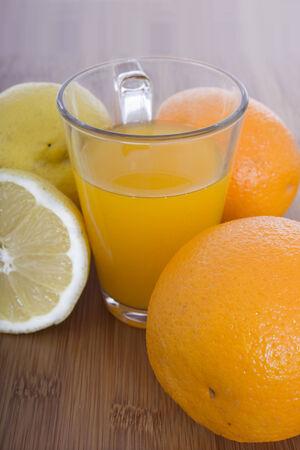 glasse of orange juice and fruits Stock Photo