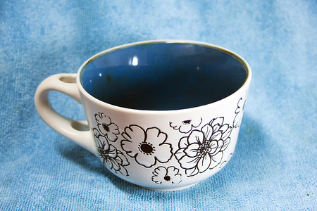 Colorful cup with background with colored fabric photo