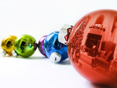 christma: These shiny Christma Ornaments reflect the Holiday Season of this decorated living room with  Christmas Tree and holiday decorations Stock Photo