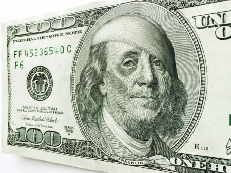 ben franklin: This photo illustration of Ben Franklin with a black eye and bandages on a one hundred dollar bill might illustrate a tough economy, inflation, unemployment, economic recession, or budget cuts etc