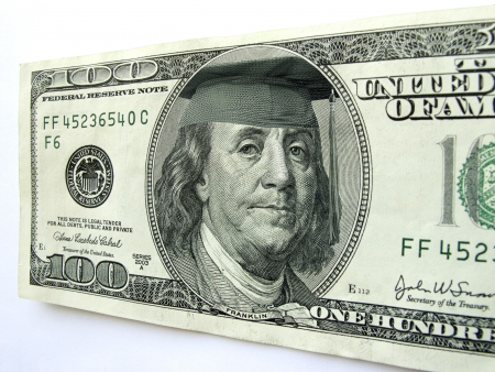 ben franklin: In this photo illustration Ben Franklin wears a cap and tassle on this one hundred dollar bill possibly illustrating the high cost of a college education, the importance of graduation from high school to earn a living wage, or the investment in a college  Stock Photo