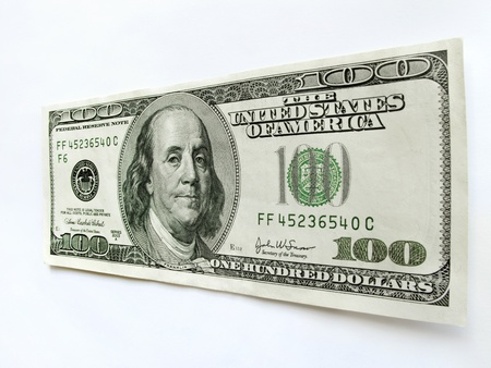 benjamin franklin: This United States One Hundred Dollar Bill with a portrait of Benjamin Franklin stands vertically isolated against a white backdrop with perspective focus on the amount of 100