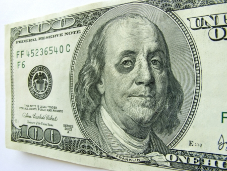 This photo illustration of Ben Franklin with a black eye on a one hundred dollar bill might illustrate a tough economy, inflation, unemployment or economic recession,or budget cuts etc