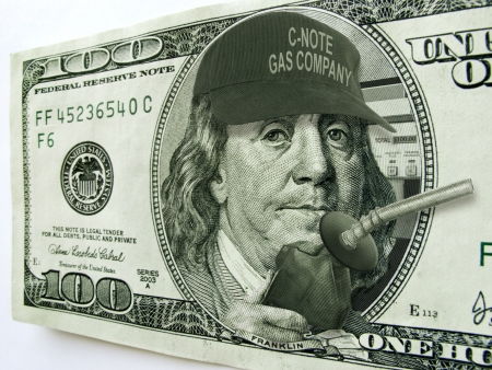 ben franklin: This photo illustration of Ben Franklin with hat and gas pump on a one hundred dollar bill illustrates the high cost of fuel and gas prices on the economy and the consumer