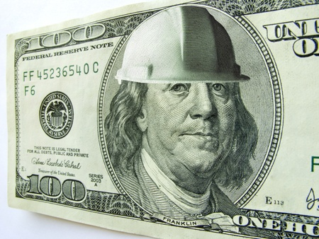 ben franklin: Ben Franklin wears a hard hat on this one hundred dollar bill which might illustrate the cost of construction or safety in a business or industrial environment