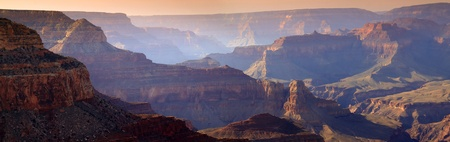 This majestic sunset photo at the South Rim of the Grand Canyon captures the amazing layers of landscape and quality of light  photo