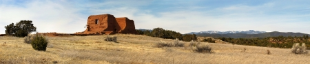 This beautifual early spring panoramic scene of the Pecos National Historic Park along the Santa Fe Trail in New Mexico includes all of the elements of a southwestern scene including adobe buildings, pinon pines, cactus, tall dry desert grasses, rolling h Фото со стока - 22177139