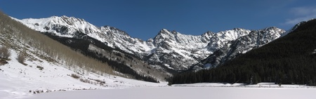 This is a panoramic stitch of the beautiful snow covered Rocky Mountain peaks near Vail Colorado