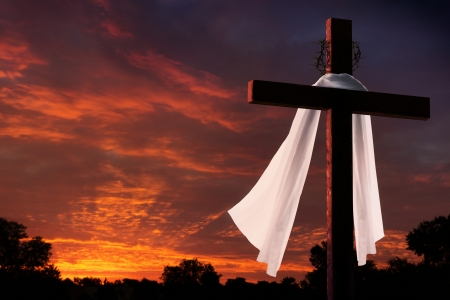 religious event: Dramatic Sunrise With Large Easter Morning Cross Burial Cloth and Crown Of Thorns
