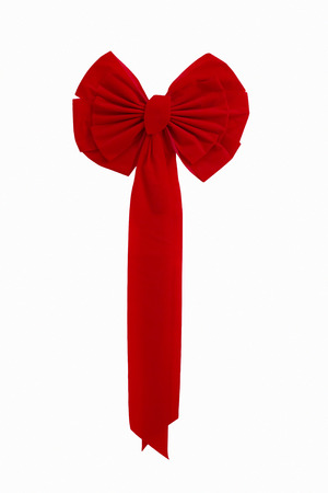 This bright red Christmas Ribbon decoration is isolated on white and large enough to cover many holiday designs  Фото со стока