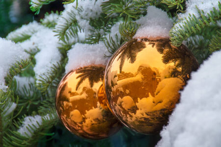 Gold Snow Covered Christmas Tree Ornaments Reflect New Mexico Adobe Buildings
