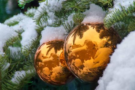 Gold Snow Covered Christmas Tree Ornaments Reflect New Mexico Adobe Buildings Фото со стока - 24472724