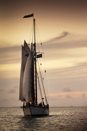 tall ship: Dramatic Mood Lighting on Sunset Sail In Key West Florida Stock Photo