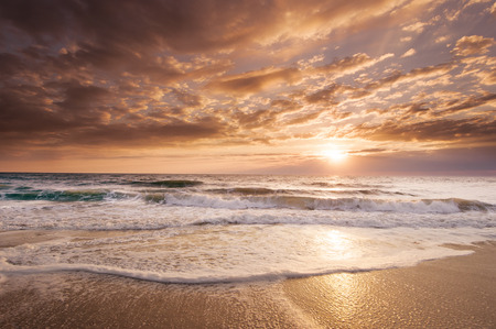 This golden Florida East Coast Sunrise reflects the tropical beauty of the region   Stock Photo