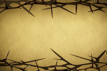 Crown of Thorns against parchment paper represents Jesus Crucifixion on Good Friday Фото со стока - 26618818
