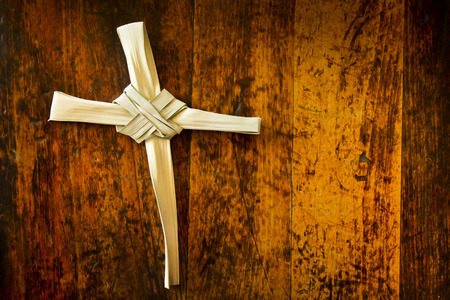 palm sunday: Holy Week Easter Illustration With Palm Branch On Antique Wood Seat Stock Photo