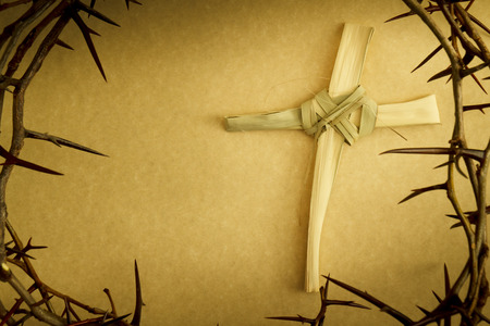 palm sunday: Easter Cross Of Palm Branch Surrounded By Crown Of Thorns