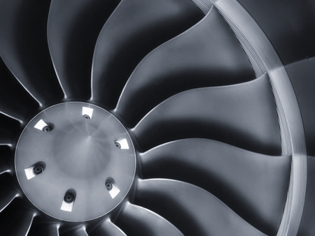 business travel: This close up image of a business aircraft jet engine inlet fan makes a great business travel or aerospace background.