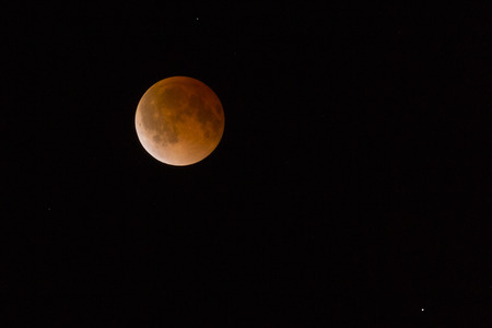 This is a photograph of the Lunar Eclipse Blood Moon moving out of its maximum stage at 3:00am Central Time.