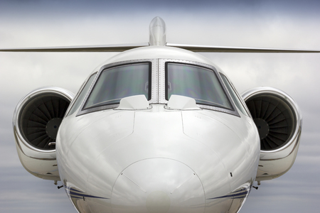 This graphic straight on perspective of a business jet would have a variety of uses in the business travel or air travel industries. Stok Fotoğraf