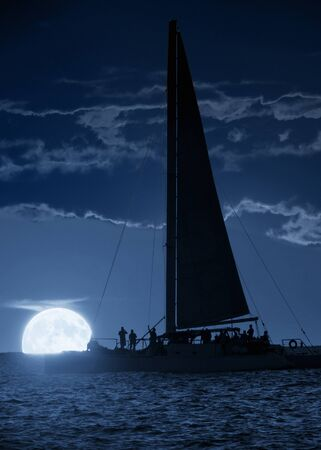 This beautiful photo illustration shows a large, blue moonrise off the coast of Key West Florida. A Wind and Wine sunset cruise on a beautifully calm and warm evening might also net you a wonderful moonrise.