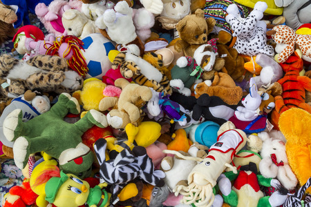 playing the market: Aerial view of a bunch of colorful dolls in a flea market