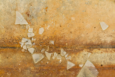 muddle: Aerial View of fragments of broken glass on a ocher ground