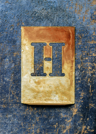 printery: Metal typography over a weathered wood background showing the alphabet letter  H