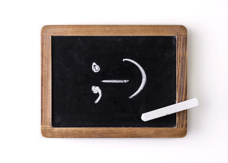 Handwritten with chalk on a blackboard  symbol ;-   wink  photo