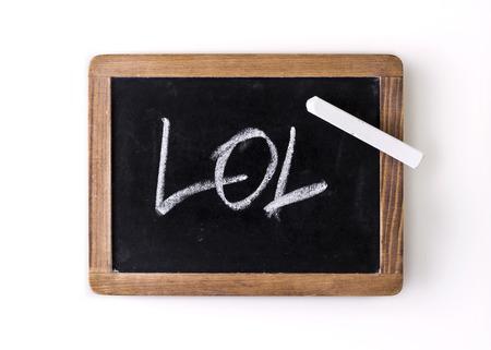 laughing out loud: Escrito a mano con tiza en una pizarra expresi�n LOL riendo a carcajadas Foto de archivo