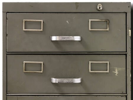 Front view of the drawers of metal filing cabinet of an old office photo